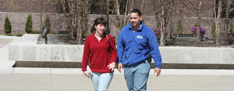 University Police student assistant walks with student